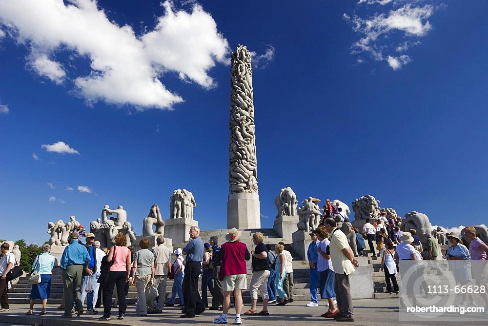 Tourist group on Monolith Plateau, granite sculptures by Gustav Vigeland in Vigeland Park, Oslo, Norway