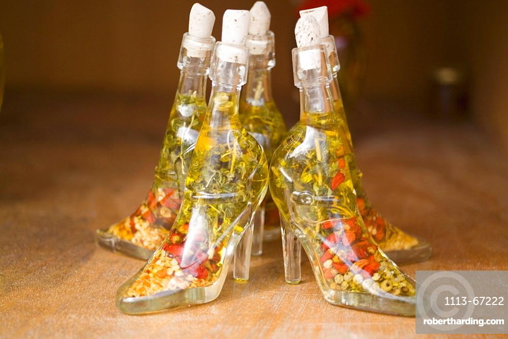 Glass shoe bottled with oil in a souvenir shop, Zia, Kos, Greece