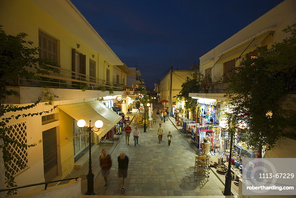 People strolling over shopping street with souvenir shops in the evening, old town, Kos-Town, Kos, Greece