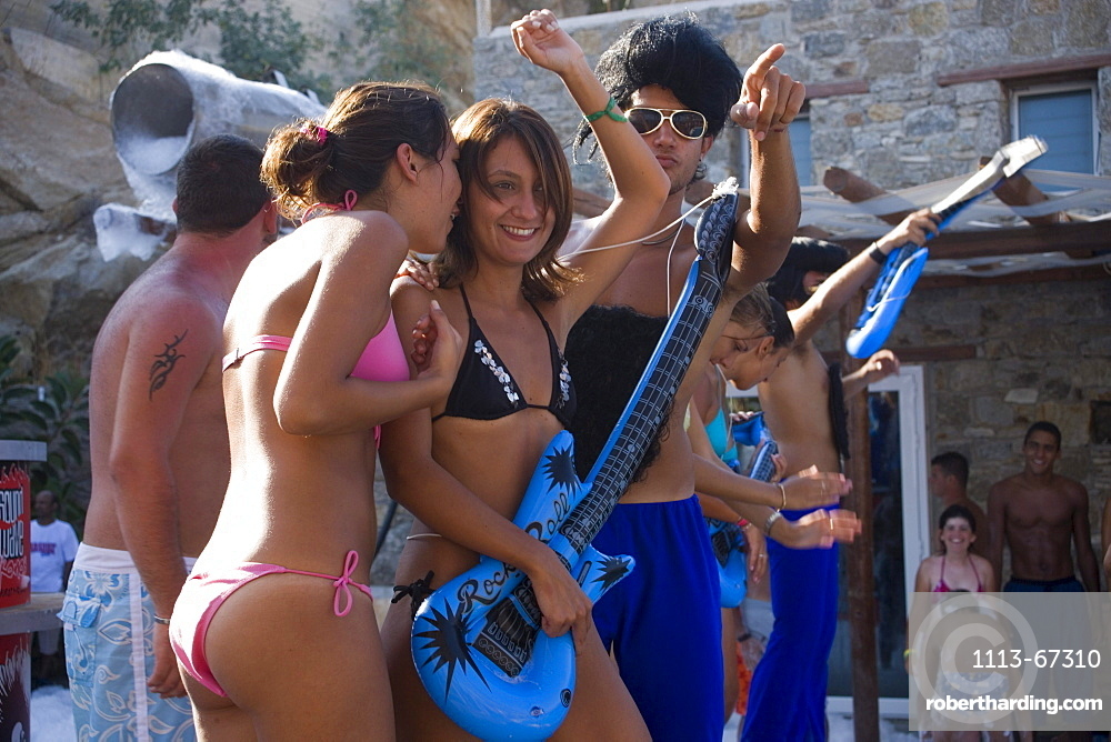 Young people amusing during a beach party of the Paradise Club, Paradise Beach, Mykonos, Greece