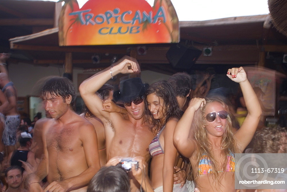 Young people dancing during a beach party of the Tropicana Club, Paradise Beach, Mykonos, Greece