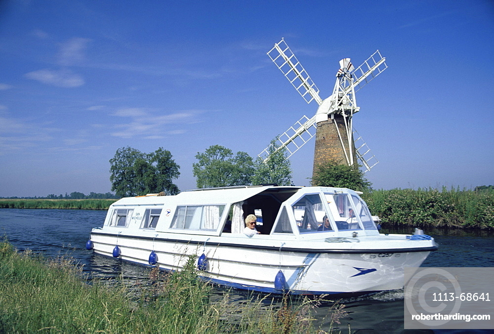 Leisure boats on canal next to How Hill windpump, Norfolk Broads, England00058427