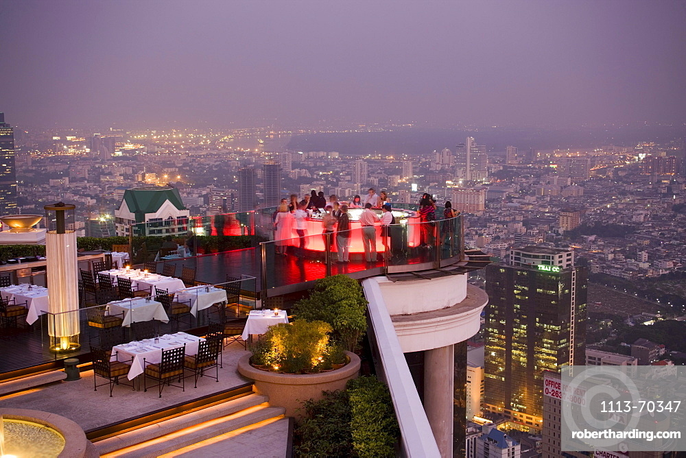 View over open air-bar Sirocco Sky Bar and Bangkok in the evening, State Tower, The Dome, Bangkok, Thailand