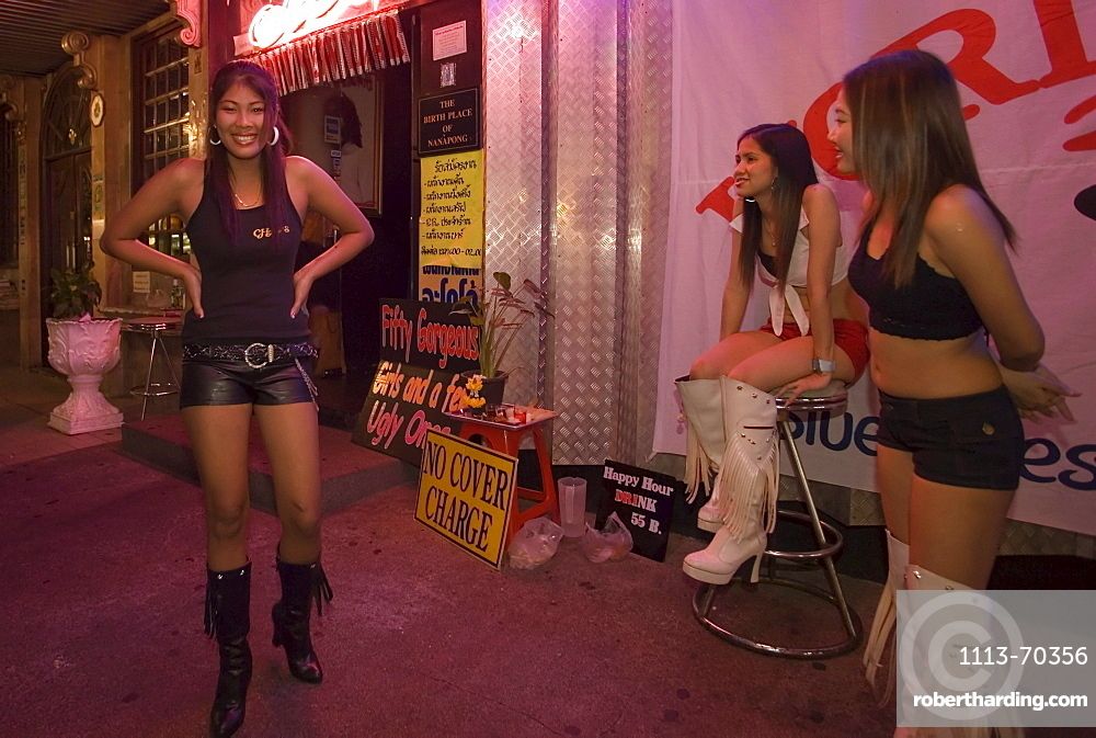 Three Go-go girls in front of a nightclub, Patpong, red light and entertainment district, Bang Rak district, Bangkok, Thailand