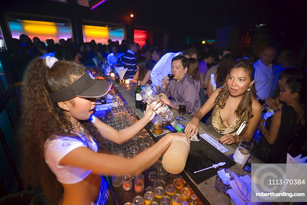 Female bartender mixing a cocktail for a woman, Q-Bar, a trendy bar for locals and expats, TH Sukhumvit, Bangkok, Thailand