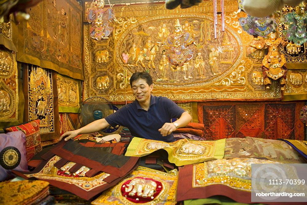 A dealer showing his goods, Suan Chatuchak Weekend Market, Bangkok, Thailand