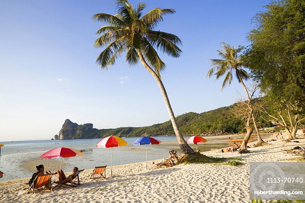 Tourists sunbathing at beach Ao Lo Dalam, Lohdalum Bay, Ko Phi Phi Don, Ko Phi Phi Island, Krabi, Thailand (after the tsunami)