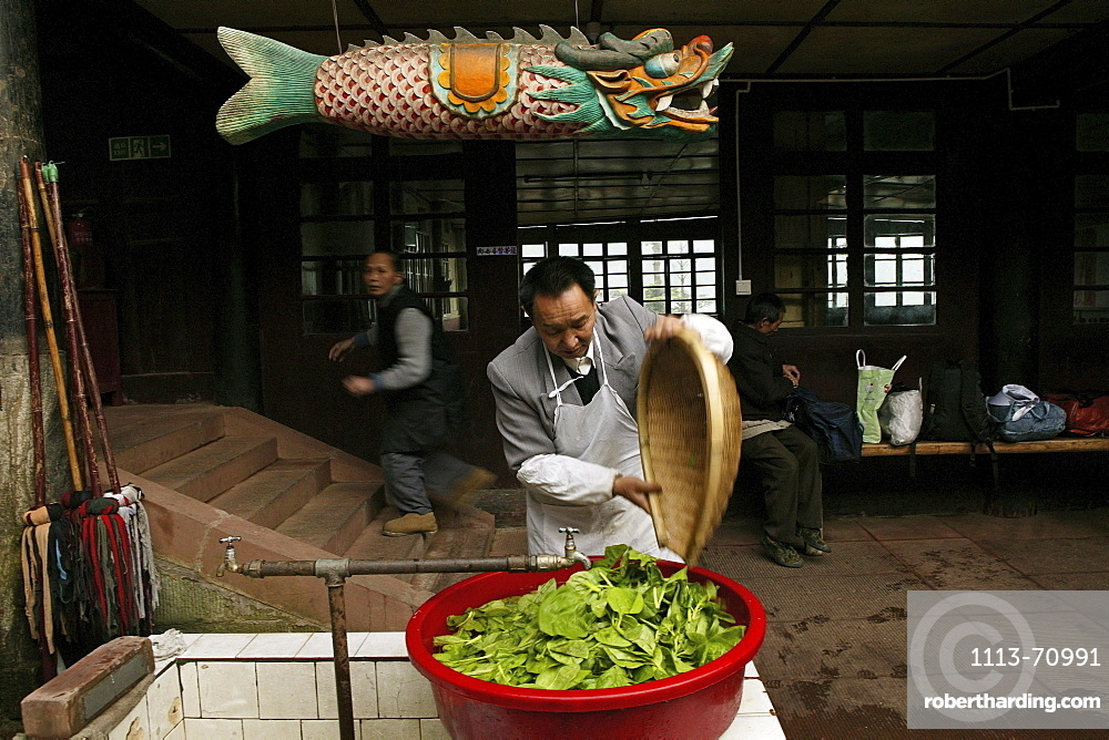 Man washing vegetables, Canteen of the Xixiang Chi monastery, Emei Shan, Sichuan province, China, Asia