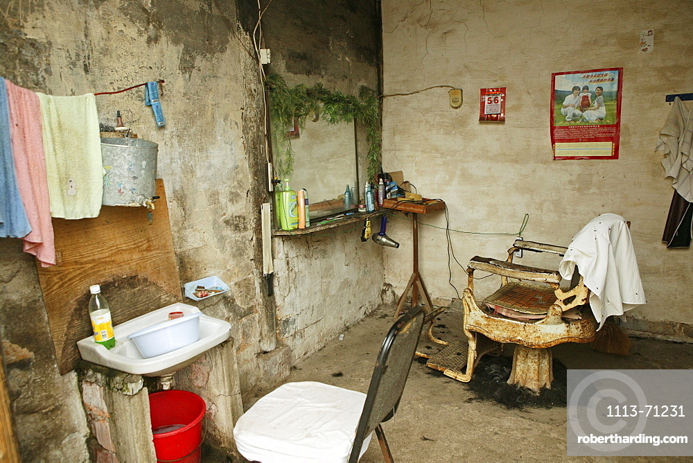 Interior view of a rural barbershop, Chengkun, China, Asia