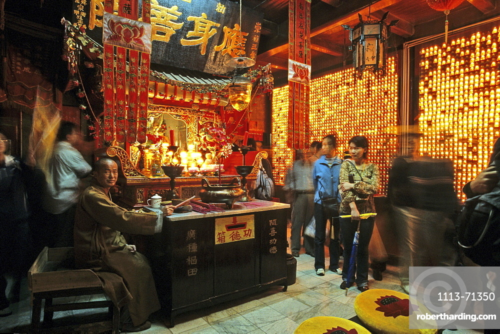 A monk and tourists at the temple of the Longevity monastery, Jiuhua Shan, Anhui province, China, Asia