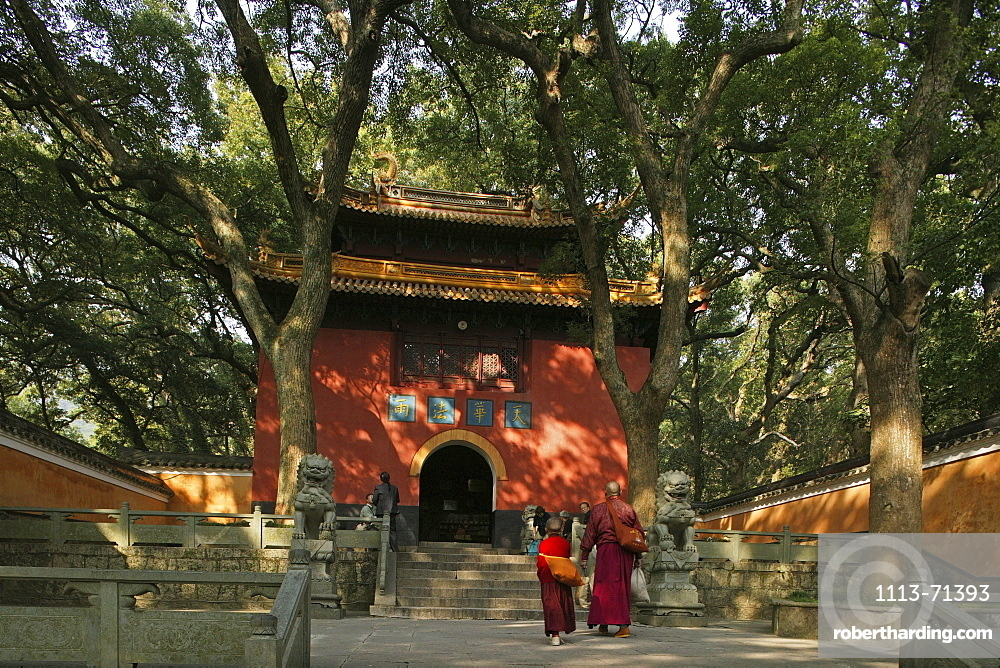 People in front of the red gate of the Fayu monastery, Putuo Shan Island, Zhejiang province, China, Asia