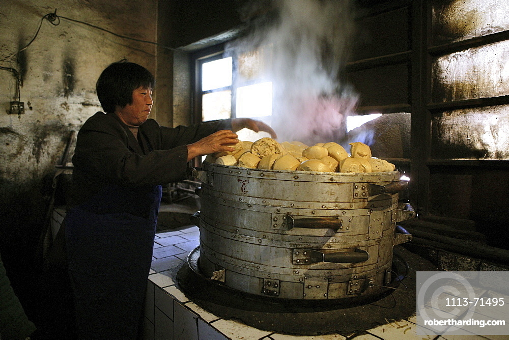 Woman making steamed buns inside the kitchen of Fawang Monastery, Shaolin monastery, known for Shaolin boxing, Taoist Buddhist mountain, Song Shan, Henan province, China