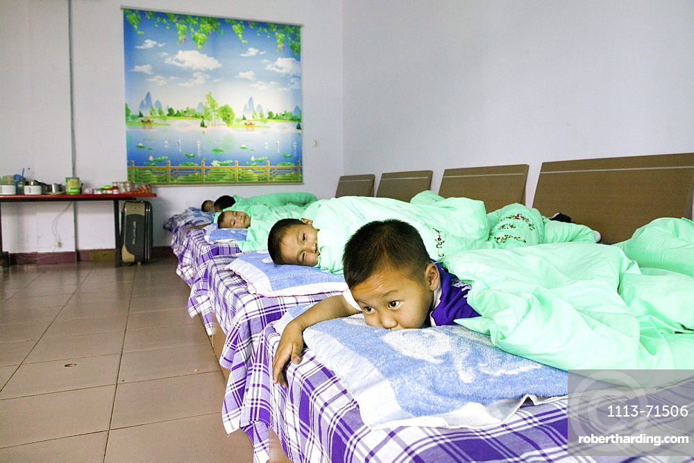 Kung Fu training at kindergarten age, at one of the many new Kung Fu schools in Dengfeng, very young pupils in the dormitory at one of the new Kung Fu Schools in Dengfeng, near Shaolin, Song Shan, Henan province, China, Asia