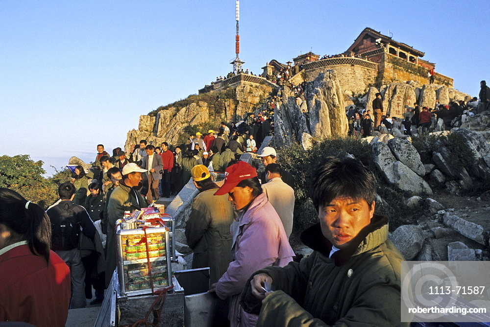 Chinese tourists crowd the summit for sunrise, salesman selling souvenirs, Mount Tai, Tai Shan, Shandong province, World Heritage, UNESCO, China