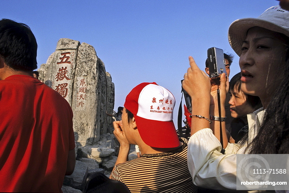 Chinese tourists crowd the summit, for the sunrise, stall sellers, Tai Shan, Shandong province, Taishan, Mount Tai, World Heritage, UNESCO, China, Asia