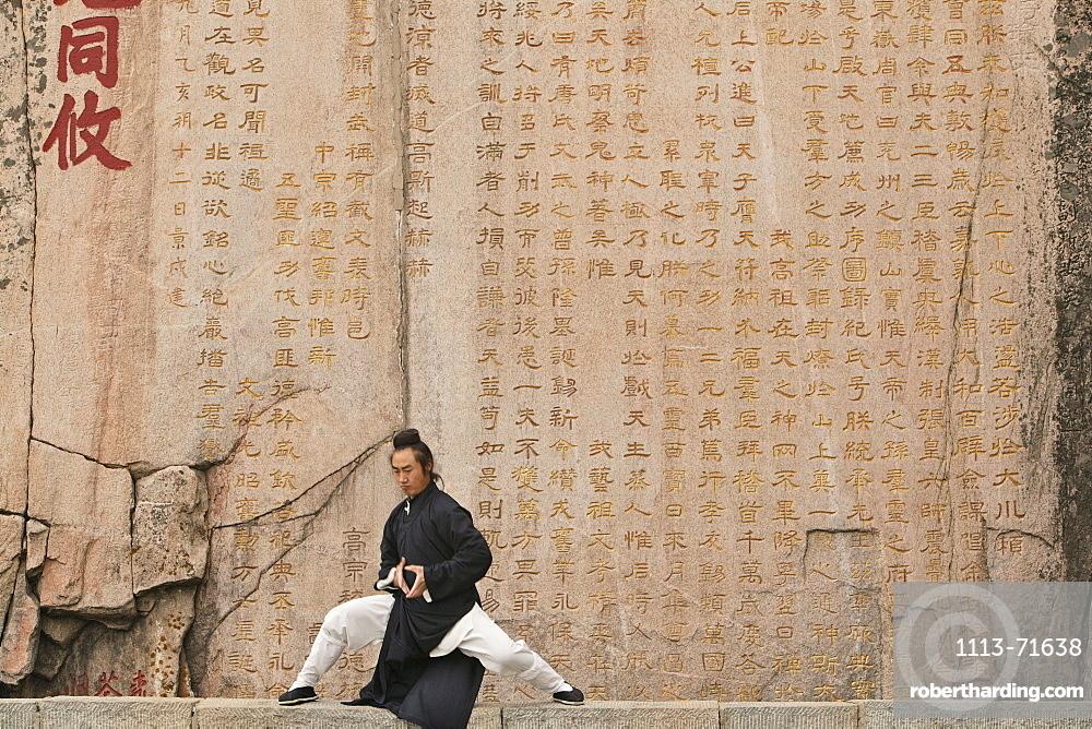 Taoist monk Zhang Qingren demonstrating Tai Ch infront of a famous inscription from Emperor Xuanzong, Hou Shi Wu Temple, Mount Tai, Tai Shan, Shandong province, World Heritage, UNESCO, China
