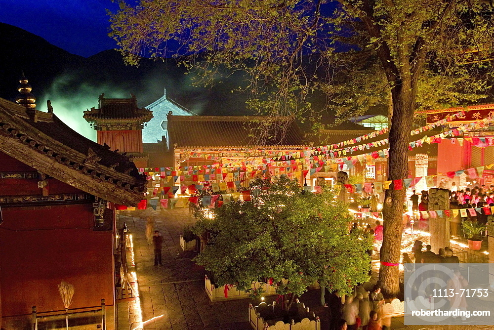 People lighting candles for the birthday celebrations of Wenshu, Shuxiang temple, Mount Wutai, Wutai Shan, Five Terrace Mountain, Buddhist Centre, town of Taihuai, Shanxi province, China