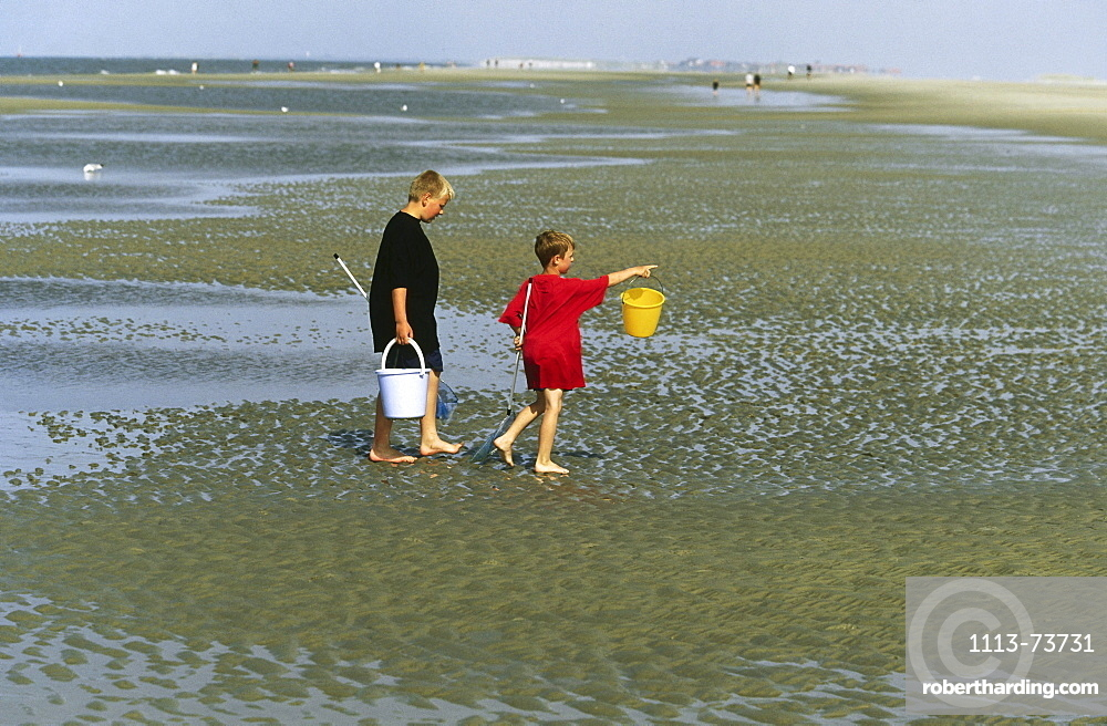 Children in mudflat, Norderney, East Frisia, Germany