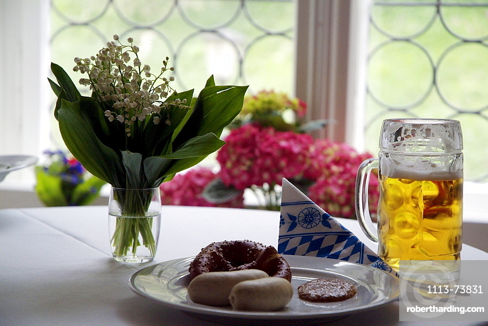 Weisswurst served with sweet mustard and accompanied be Brezen and Beer, White Sausage, Traditional Bavarian Sausage, Food, Bavaria, Germany, Prezel, Mass