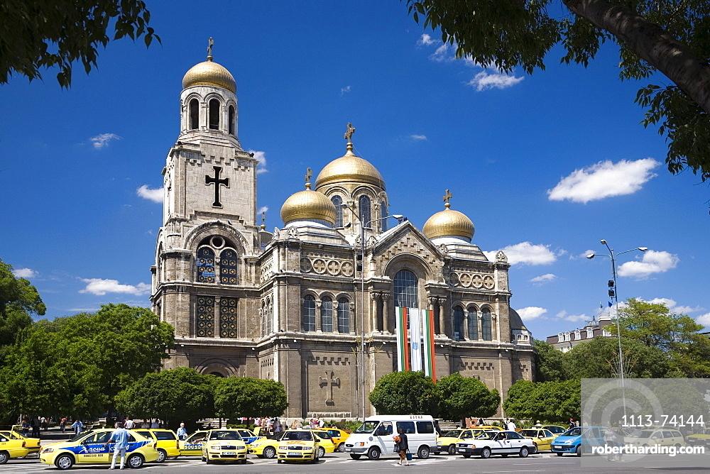 Cars in front of Chram Sveta Uspenie Bogorodicno cathedral at Varna, Bulgaria, Europe