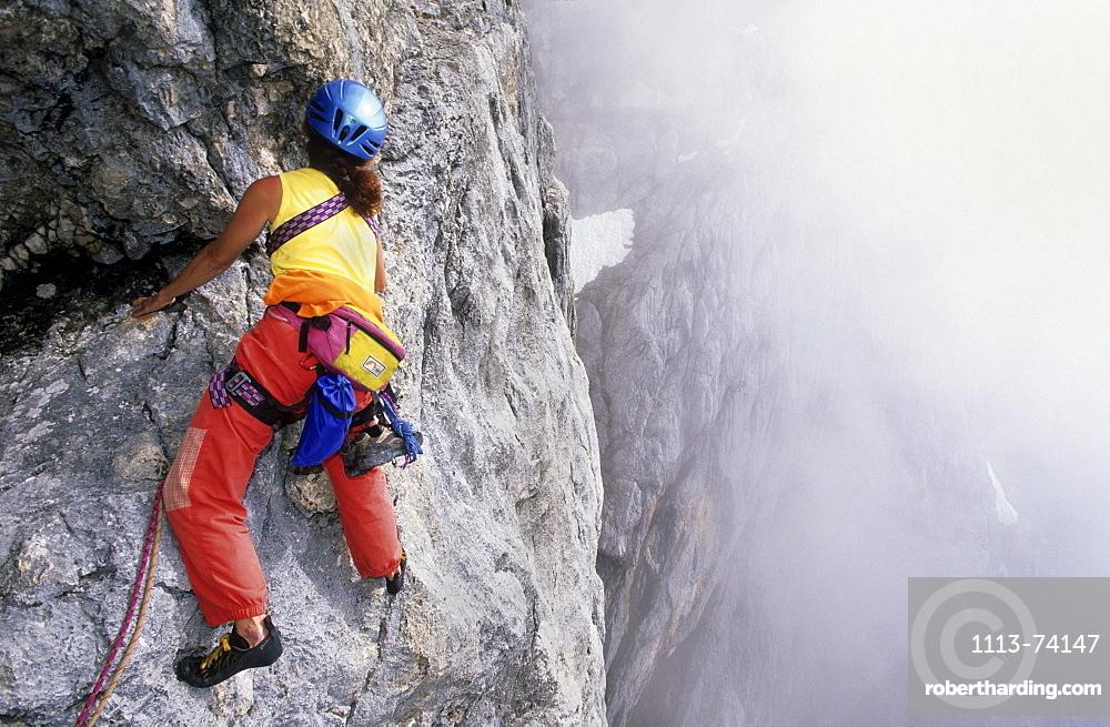 climber on south face of Dachstein, Steiner ledge, Steiner route, Dachstein range, Styria, Austria
