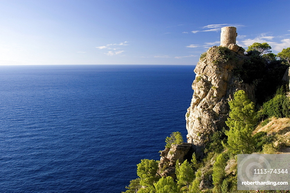 Coastal landscape with medievel watch tower, Mirador de Ses Animes, North Coast, Majorca, Spain