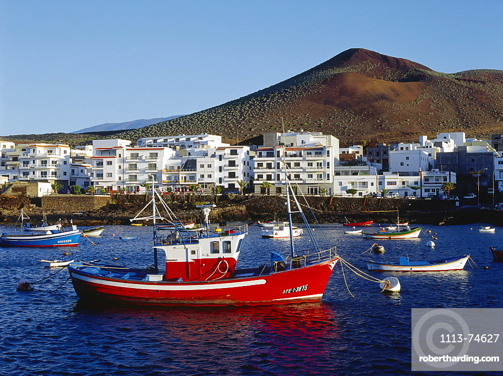 Fishing boats, fishing port, village and volcano, La Restinga, El Hierro, Canary Islands, Atlantic Ocean, Spain