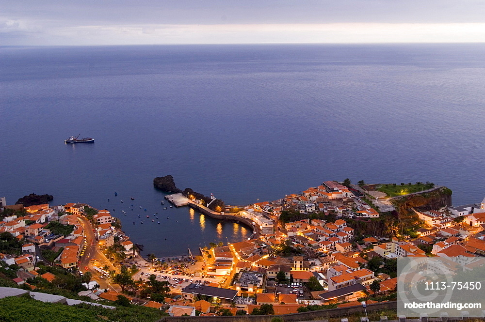 View at the houses on the coast in the evening, Camara de Lobos, Madeira, Portugal