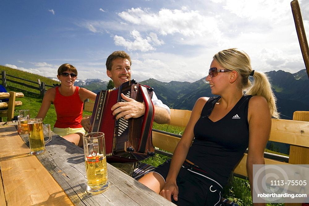 Man playing accordion, Bichlalm (1731 m), Grossarl Valley, Salzburg, Austria