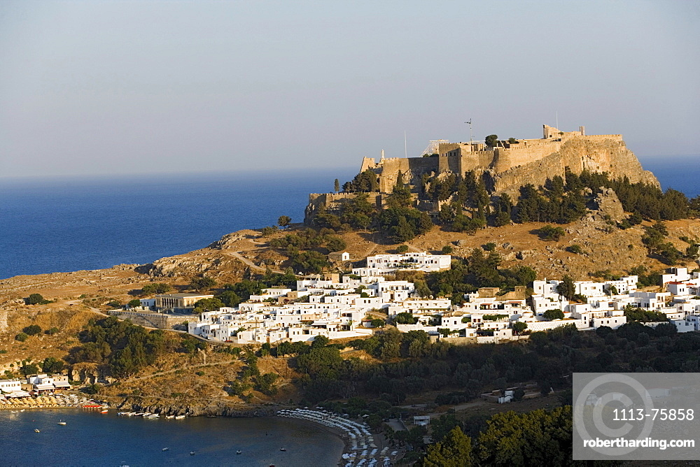 Elevated view of Lindos Bay and town with Acropolis, Lindos, Rhodes, Greece