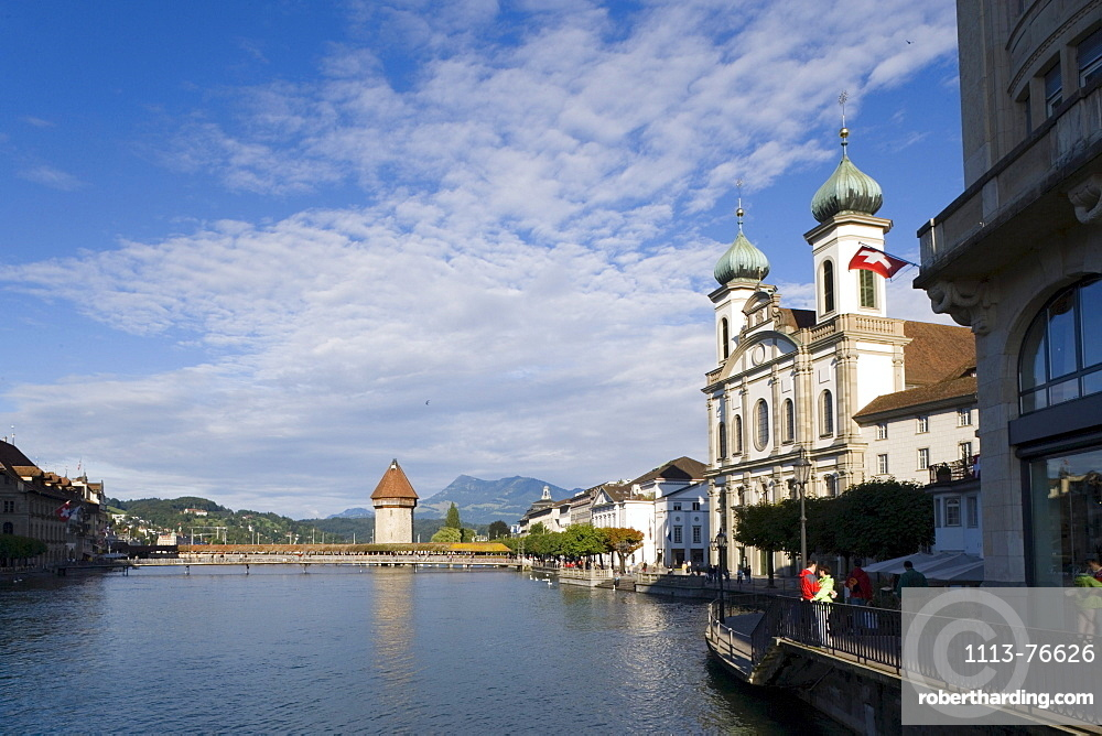 View along river Reuss with Jesuit Curch, first large sacral baroque building in Switzerland, and Kapellbruecke (chapel bridge, oldest covered bridge of Europe) with Wasserturm, Lucerne, Canton Lucerne, Switzerland