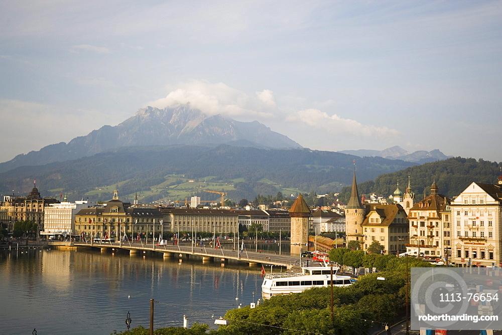 Seebruecke, Kapellbruecke (chapel bridge, oldest covered bridge of Europe) and Wasserturm, mountains in background, Lucerne, Canton Lucerne, Switzerland