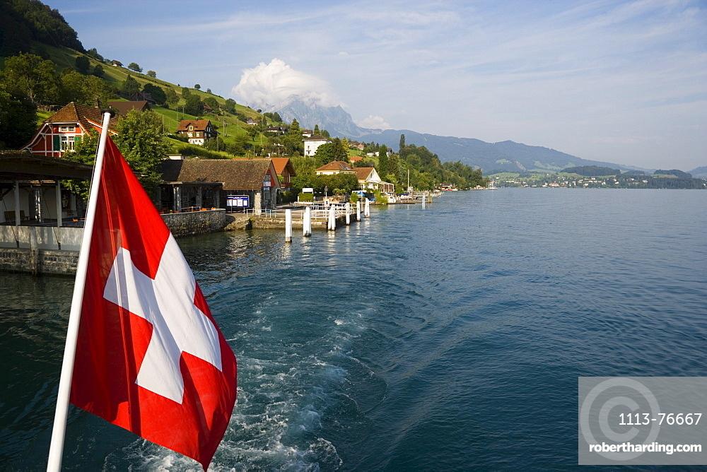 Swiss flag, Kehrsiten Buergenstock, Pilatus (2132 m) in background, Kehrsiten Buergenstock, Canton of Lucerne, Switzerland