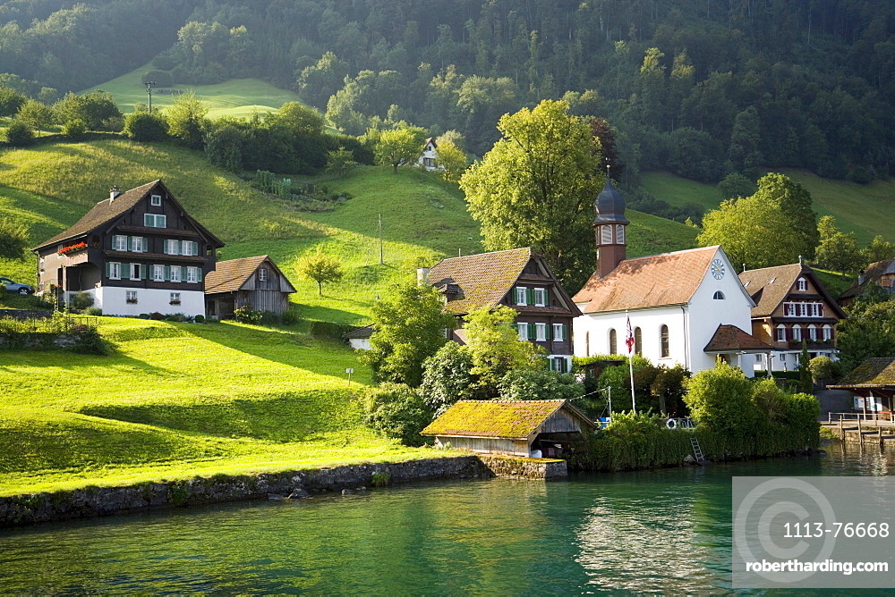 View over Lake Lucerne to Kehrsiten Dorf with church, Canton of Lucerne, Switzerland
