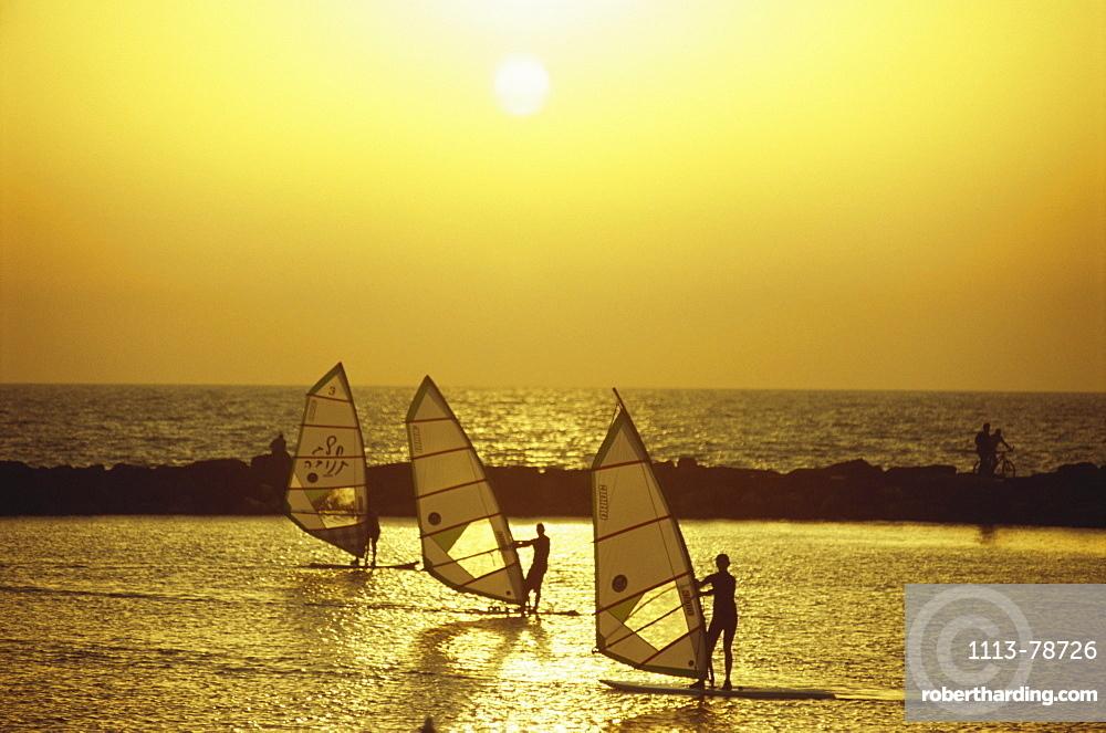 Windsurfers enjoying the sunset in the New Port Area, Tel-Aviv, Israel