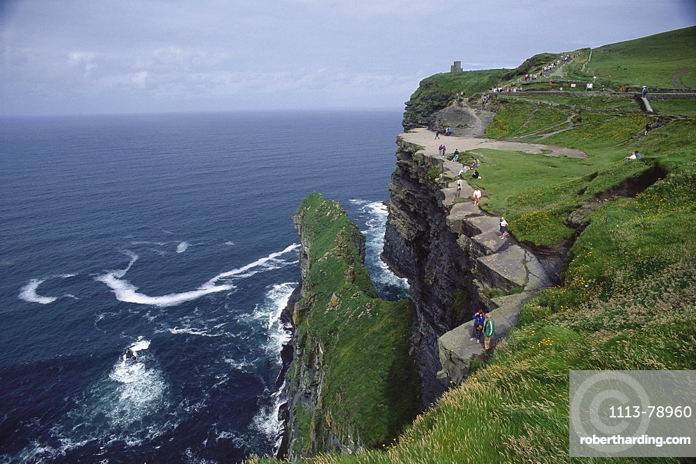 People walking along the Cliffs of Mother, County Clare, Republic of Ireland