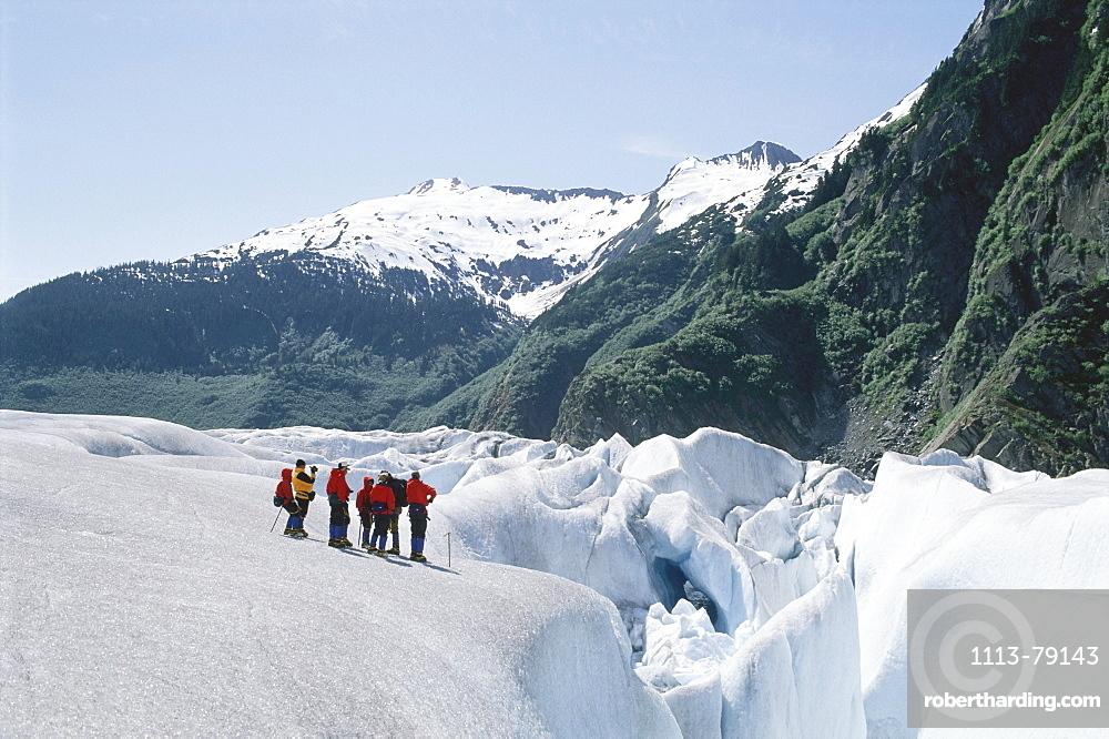 A group of people on a glacier tour near Juneau, Alaska, USA