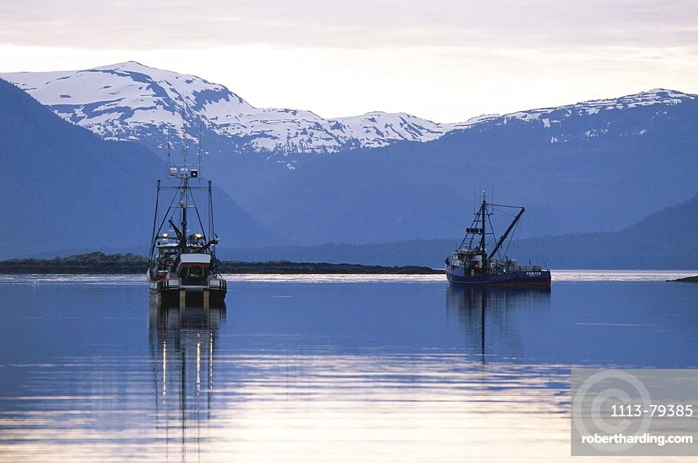 Fishing boats, Inside Passage of the Alaskan Panhandle, Mountains, Southeast Alaska, USA