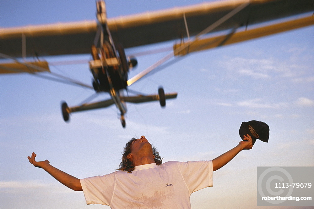 Mircolight plane flying over a person, airplane flying over an airport, Fly Ranch, Buenos Aires, Argentina
