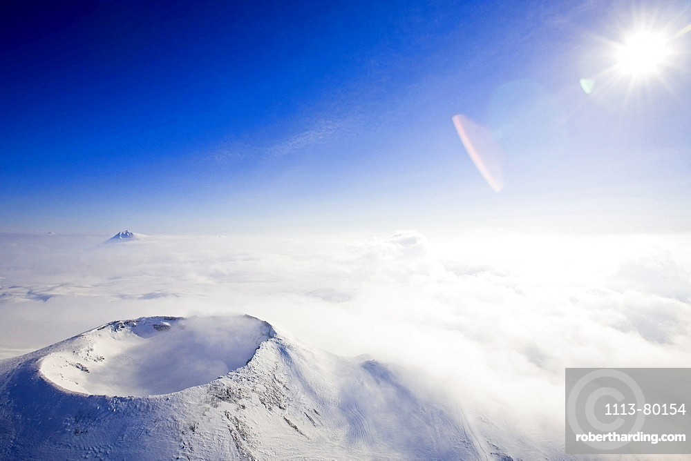 A crater of a volcano and clouds on top of the volcano Gorely, Kamtchatka, Sibiria, Russia