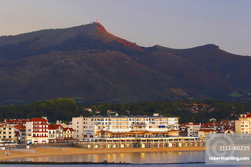 At sunset in the seaside resort St. Jean de Luz with Casino and view to La Rhune, Cote des Basques, dept PyrÈnÈes-Atlantiques, France, Europe