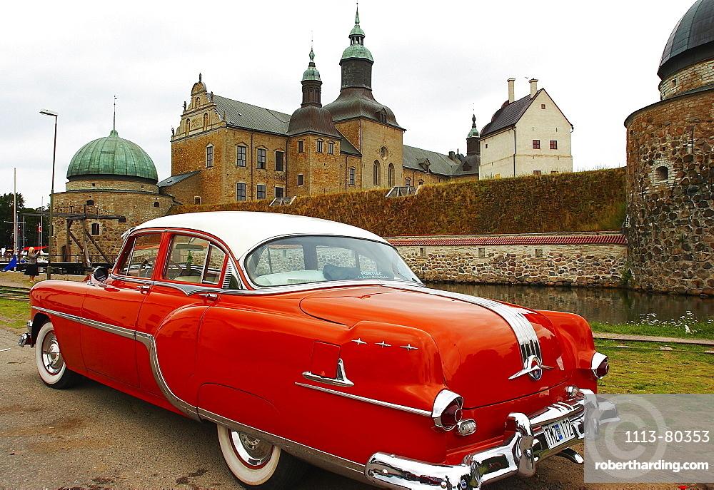 Castle with oldtimer in Vadstena, Oestergoetland, southern Sweden
