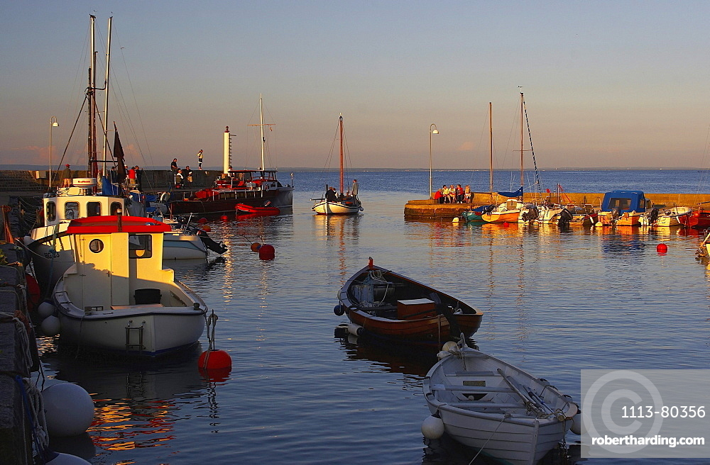 Last sun rays at the harbour of Arlid, Skane, southern Sweden