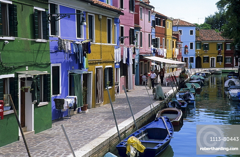 canal with boats and colourful houses in Burano, Venice, Venezia, Italy