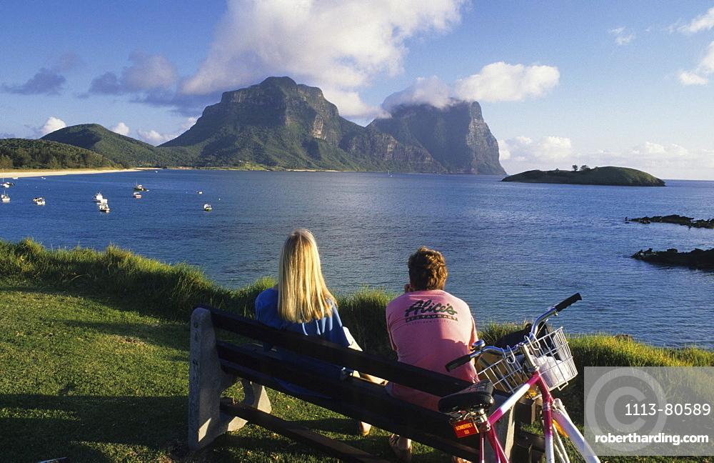 People looking across the lagoon to Mt. Lidgbird and Mt. Gower, Lord Howe Island, Australia