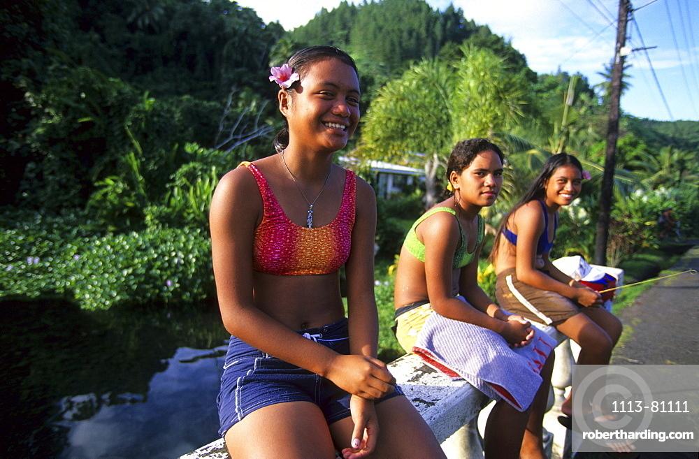 Three local girls along the coast road, Tahiti, French Polynesia, south sea