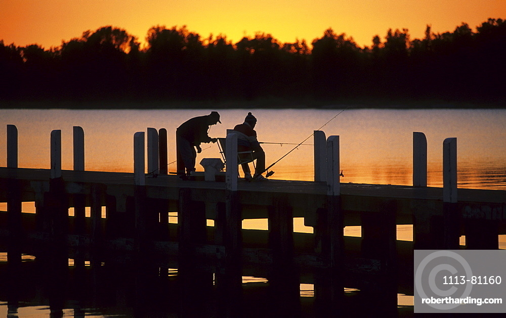 Fishermen on the jetty at sunset, Lakes Entrance, Victoria, Australia