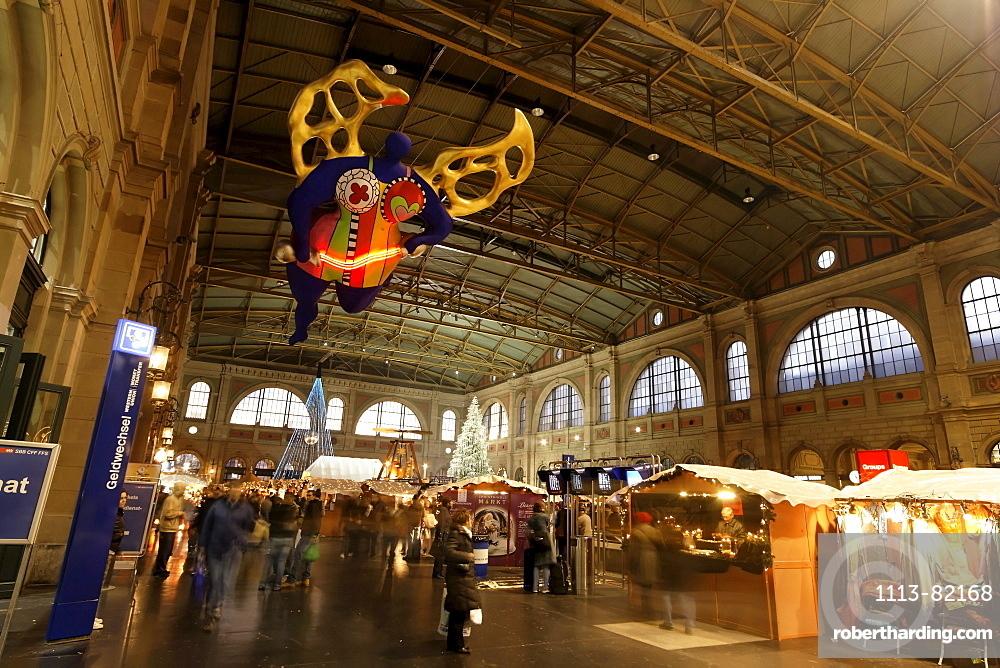 Zuerich, main station, christmas decoration, interieur Niki de Saint Phalles angel of travellers