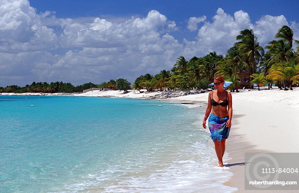 Woman walks on sandy beach, Punta Cana, Caribbean, Dominican Republic