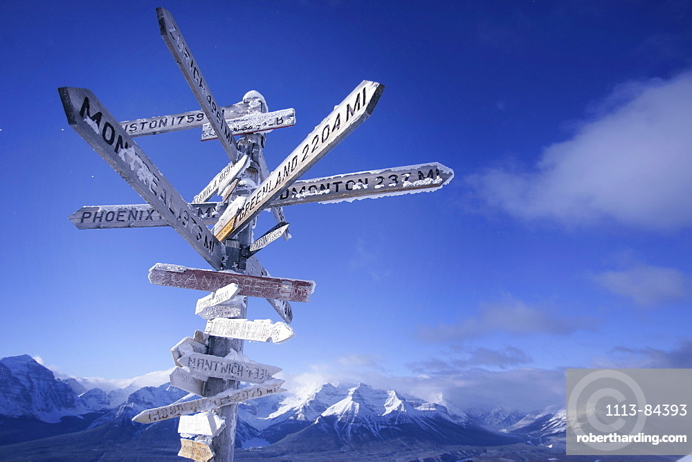 Sign post with distance plates, ski resort, lake louise, Alberta, Canada